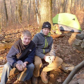 two scouts in front of tents on the Appalachian Trail