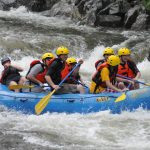 group of young men whitewater rafting